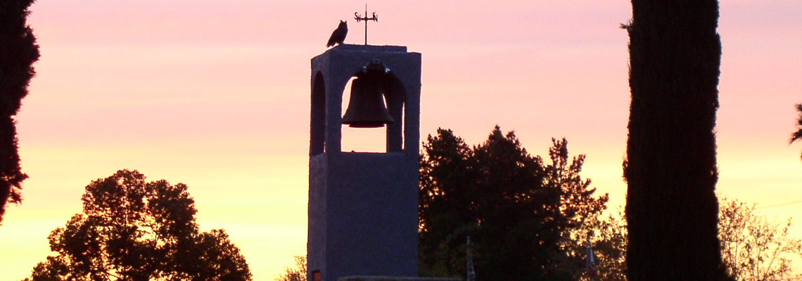 Picture of Bell Tower with Sunset Background at Mountain View Cemetery.